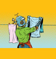 vintage robot employee hangs up to dry clothes vector image
