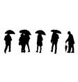 silhouettes people with umbrellas vector image vector image
