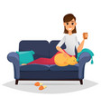 woman on a comfortable sofa holding cup and vector image