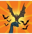 Evil bat sitting on the hand vector image vector image