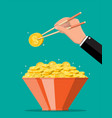 bowl full gold coins and chopsticks in hand vector image