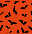 halloween orange background with bats silhouettes vector image vector image