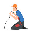 male electrician engineer sitting on his knee vector image