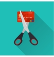 Red credit card cutting by the scissors vector image