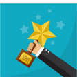 hand holds a star award vector image vector image