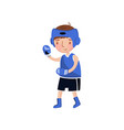 little boy boxer in blue uniform and boxing gloves vector image vector image