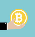 bitcoin sign in hand money and finance vector image vector image