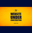 website under construction sign on a brick wall vector image