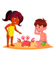 squatting kids watching a crab on the beach vector image