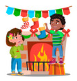 two kids hanging christmas socks on decorated vector image vector image