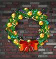 christmas wreath on old brick wall vector image
