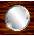 Metal circle-plate on wooden surface vector image vector image