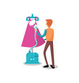 male dressmaker ironing clothing with steam iron vector image