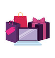 laptop with shopping bag and gift vector image vector image