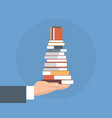 hand hold books stack school education concept vector image