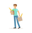 young smiling man carrying two bags with food vector image vector image