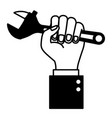 hand holding adjustable wrench flat icon black vector image vector image