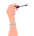 elegant women s hand holding a mascara wand on vector image