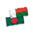 flags madagascar and bangladesh on a white