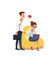 couple in love sit in beanbag chair with laptop vector image