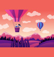 couple on hot air balloon above mountains vector image