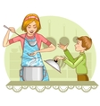 Mother and son tests food in the kitchen vector image vector image