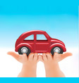 red car in hands vector image