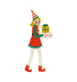christmas elf character carrying gift boxes cute vector image vector image