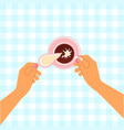 hands holding a cup vector image vector image