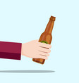 left hand holding a beer bottle and blue vector image vector image