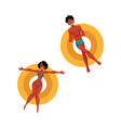 Black african young man and woman floating on