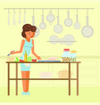 Woman cooking in kitchen flat