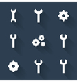 Gear and wrench white icons set over blue vector image vector image