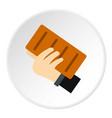 Hand holding a brick icon circle
