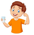 cartoon little boy holding a glass milk vector image vector image