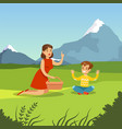 happy mother and son having picnic vector image vector image