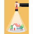 Hand holding flashlight glow to the house property vector image vector image