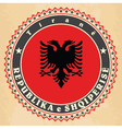Vintage label cards of Albania flag vector image