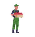 agricultural worker farmer with harvest box man vector image