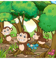 Three monkeys playing at the forest vector image