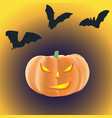halloween pumpkin with burning eyes on a dark vector image vector image