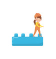 cute girl builder and buiding toy block preschool vector image