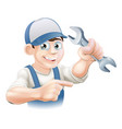 plumber or mechanic pointing vector image vector image