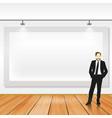 a businessman standing beside big blank banner vector image