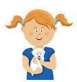 cute little girl with pigtails holding white puppy vector image vector image