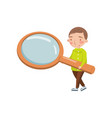 little boy holding giant magnifying glass vector image vector image