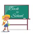 back to school written on green blackboard girl vector image