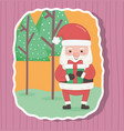 cute santa with gift and trees merry christmas vector image