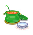 Iron pan with hot soup and some plates vector image