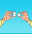 pop art female hands holding two puzzle pieces vector image